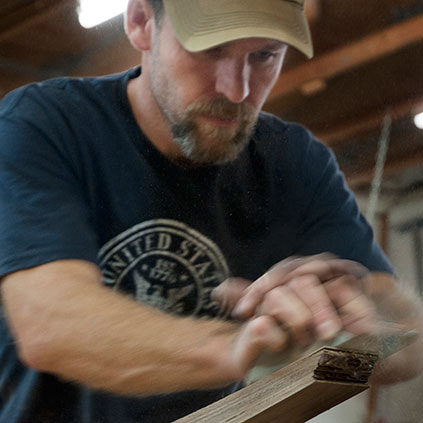 Brian Hubel designing custom furniture or handmade furniture